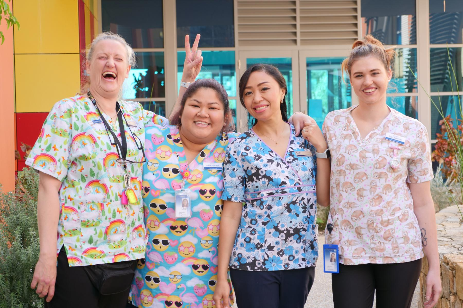 Staff Enjoying Rainbow Shirt Day